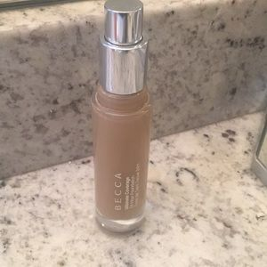 BECCA 24 HOUR FOUNDATION IN TAN SWATCHED